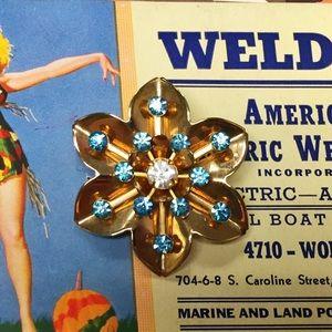 Vintage rhinestone snowflake brooch